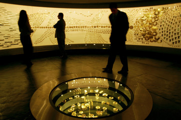 Colombian people look at objects on display in the Gold Museum in Bogota.