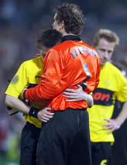 ROSICKY OF DORTMUND IS COMFORTED BY LEHMANN AFTER THE UEFA CUP FINAL INROTTERDAM.