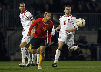 Luxembourg's Strasser and Peters chase Belgium's Vanden Borre during their international friendly soccer match