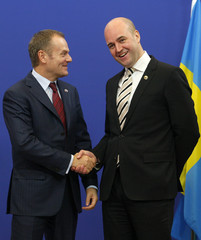 Poland's PM Tusk is welcomed by Sweden's PM Reinfeldt  in Brussels