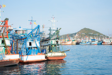 Fishing boats to recreational fishing are moored in the harbor at  Chonburi, Thailand