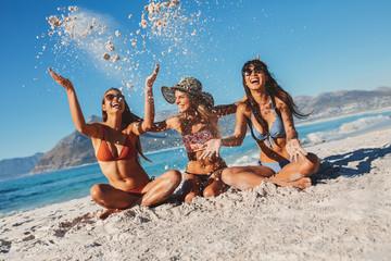 Female friends enjoying holidays on the sea shore