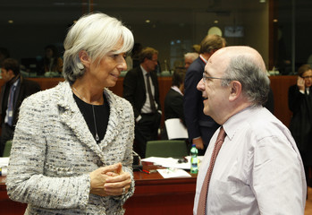 France's Finance Minister Lagarde listens to EU Commissioner Almunia during EU finance ministers meeting in Brussels