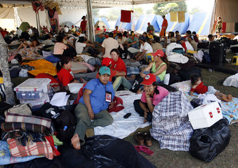 Members of the Landless Movement rest in a tent at the camp in downtown