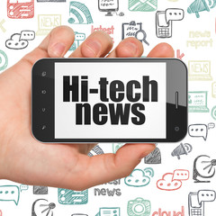 News concept: Hand Holding Smartphone with Hi-tech News on display