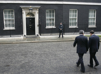 Britain's Prime Minister Gordon Brown walks into Downing Street  with his Iraqi counterpart Nouri Al-Maliki in London