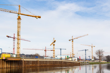 Large construction site with tower cranes