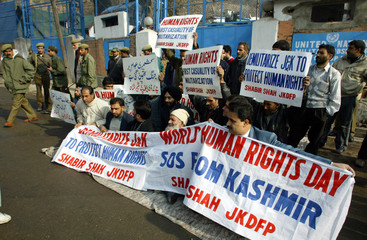 Kashmiri leaders and activists of Democratic Freedom Party stage protest outside the office of UNMOGIP in Srinagar