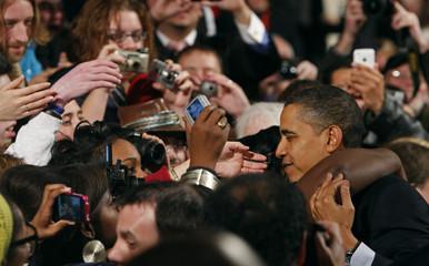 U.S. President Barack Obama gets a hug after delivering remarks at Lehigh Carbon Community College in Allentown, Pennsylvania