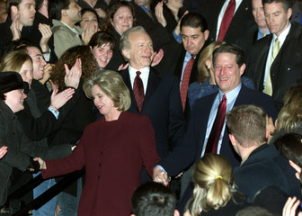 U.S. Vice President Al Gore walks out of the Old Executive Office Building with his wife Tipper and ..