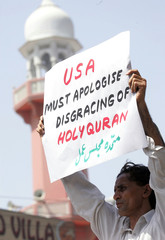 Pakistani protestor holds a placard during an anti-US rally in Karachi.