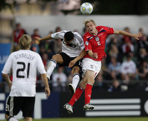 England's Stearman challenges Germany's Ben-Hatira during their U21 European Championship soccer match in Halmstad