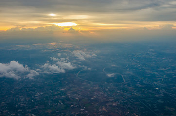 sunrise ,Sky and cloud as seen through window of an aircraft,selective focus