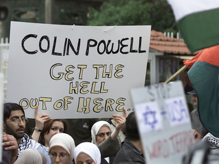 SYRIANS AND PALESTINIAN REFUGEES HOLD BANNERS CALLING ON COLIN POWELLTO GET OUT OF SYRIA.