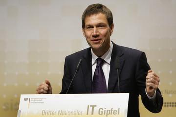 Obermann, CEO of Deutsche Telekom, gestures during his speech at the third national IT summit in Darmstadt