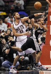 San Antonio Spurs Tony Parker unloads a pass in their NBA basketball game in East Rutherford