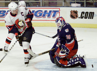 SENATORS' ARVEDSON TRYS TO AVOID STICK CHECK BY RANGERS' NEDVED IN SECOND PERIOD.