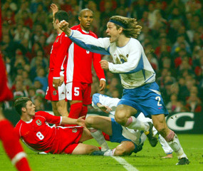 RUSSIA'S VADIM EVSEEV CELEBRATES AFTER SCORING THE OPENING GOAL DURINGTHE EURO 2004 PLAYOFF MATCH ...
