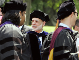 Federal Reserve Chairman Bernanke looks on as Boston college law school graduates proceed into their commencement ceremony in Newton