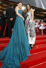 "Jury members Taiwan actress Shu and  Italian actress Argento pose on red carpet as they arrive for screening of the animated film ""Up"" by director  Docter on opening night of 62nd Cannes Film Festival"