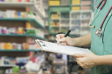 female doctor,surgeon,nurse,pharmacy with stethoscope on hospital holding clipboard,writing a prescription,Medical Exam,Healthcare and medical concept,test results,patient registration,selective focus