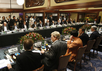 Delegates of the G8 Finance Minister Meeting attend the outreach dinner at Japanese restaurant Yodogawatei in Osaka, western Japan