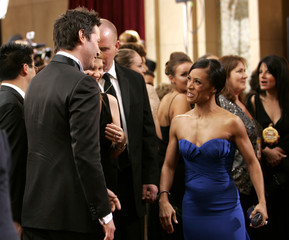 Actors Keanu Reeves (l) and Jada Pinkett Smith (r) greet each other on the red carpet at the 78th annual Academy Awards in Hollywood