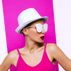 Stylish Girl in sunglasses and hat. Minimal pop art beach fashion