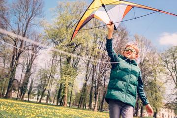 Boy try to start fly kite