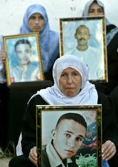 LAYLA HELES HOLDS A PICTURE OF HER SON ALI HELES IN GAZA CITY.