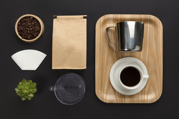Top view of a black desk with coffee hand brewing supplies