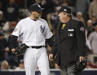 New York Yankees starting pitcher Pettitte talks to home plate umpire West in Game 6 of the 2009 Major League Baseball World Series in New York