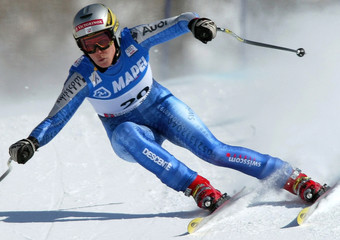 SWISS STYGER TAKES A CURVE TO WIN THE WOMEN'S SUPER-G RACE IN SESTRIERE.