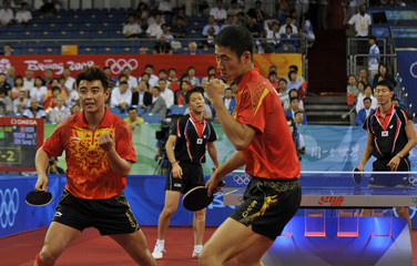 Wang Liqin and Wang Hao of China celebrate their victory against Yoon Jae-Young and Oh Sang-Eun of South Korea during their men's team semifinal table tennis doubles match at the Beijing 2008 OIympic Games