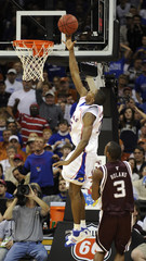 University of Kansas Jayhawks' Mario Chalmers makes dunk after stealing ball from  Texas A&M Aggies' Derrick Roland