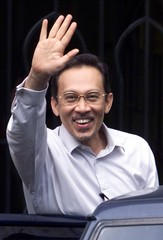 MALAYSIA'S JAILED FORMER FINANCE MINISTER ANWAR IBRAHIM WAVES AS HE LEAVES THE COURTHOUSE IN KUALA ...