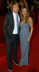 Owen Wilson and Jennifer Aniston pose for photographers in London