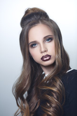 Beauty portrait of a beautiful girl with a shiny makeup.