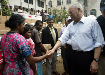 US Secretary of State Colin Powell meets Sri Lankan tsunami survivors during visit to Red Cross ...