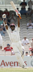 West Indies' Chanderpaul celebrates his 100 during the fifth day of their third test cricket match aginst England at Old Trafford in Manchester