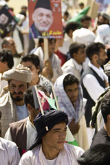 Supporters of Afghan President Hamid Karzai attend an election campaign at a stadium in Herat