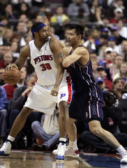 Detroit Pistons' Wallace drives against New Jersey Nets' Jianlian during the first half of their NBA game in Auburn Hills