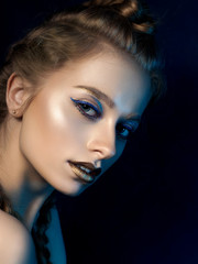 Beauty portrait of young woman with modern make up