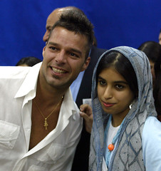 UNESCO Goodwill Ambassador Martin poses with an Arab Gulf girl during his visit in Amman.