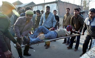 Injured Kashmiri man is rushed to a hospital in Srinagar