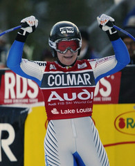 FRENCH SKIER CAROLE MONTILLET CELEBRATES HER SECOND DOWNHILL WIN IN AROW.