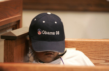 Sir-William Simpson sleeps in a pew under his President-elect Senator Obama hat while awaiting results in Atlanta