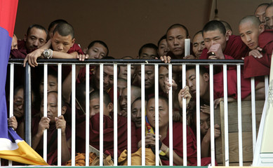 Buddhist monks watch a function to mark the 50th anniversary of a failed uprising in Mcleodganj