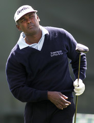 Vijay Singh watches drive during delayed Bay Hill first round.
