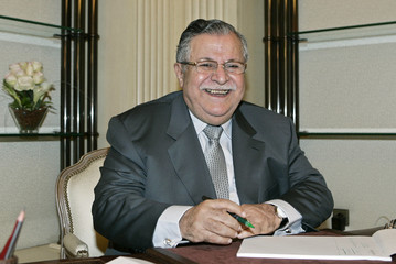 Iraqi President Jalal Talabani smiles during an interview in Damascus
